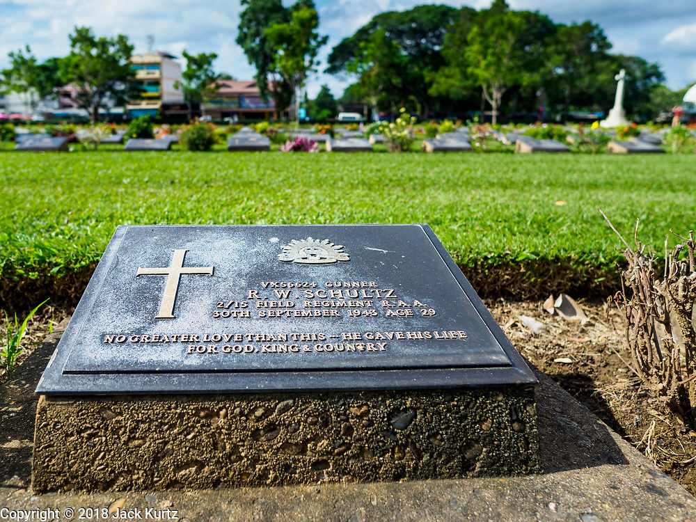 """11 NOVEMBER 2018 - KANCHANABURI, KANCHANABURI, THAILAND:  The headstone of a World War II Commonwealth soldier in the Kanchanaburi War Cemetery in Kanchanaburi, Thailand. Kanchanaburi is the location of the infamous """"Bridge On the River Kwai"""" and was known for the """"Death Railway"""" built by Japan during World War II using allied, principally British, Australian and Dutch prisoners of war as slave labor. There are 6,982 people buried in the cemetery, 5,000 Commonwealth soldiers and 1,800 Dutch soldiers. November 11, 2018 marked the 100th anniversary of the end of World War I, celebrated Rememberance Day in the UK and the Commonwealth and Veterans' Day in the US.     PHOTO BY JACK KURTZ"""