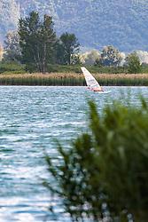 THEMENBILD - ein Winsurfer nützt den Wind am See, aufgenommen am 22. Mai 2017, Kalterer See, Kaltern, Italien // A Winsurfer takes advantage of the wind at the Lake Caldaro, Kaltern, Italy on 2017/05/22. EXPA Pictures © 2017, PhotoCredit: EXPA/ JFK