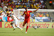 Daniel Van Buyten of Belgium goes past Maksim Kanunnikov of Russia (L) during the 2014 FIFA World Cup match at Maracana Stadium, Rio de Janeiro, Brazil. <br /> Picture by Andrew Tobin/Focus Images Ltd +44 7710 761829<br /> 22/06/2014