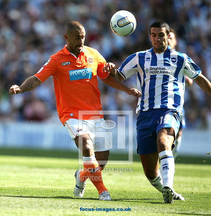 Picture by Paul Terry/Focus Images Ltd..20/8/11.Gary Dicker  of Brighton and Kevin Philiips of Blackpool during the Npower Championship match at the American Express Community Stadium, Brighton, West Sussex.