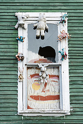 House covered in stuffed animals and dolls, Heidelberg Project, Detroit, Michigan.  The Heidelberg Project is a grass roots project started by artist Tyree Guyton that uses art to help revitalize the embattled neighborhood.  Each year, over 275,000 people visit the project .  For more information, go to www.heidelberg.org