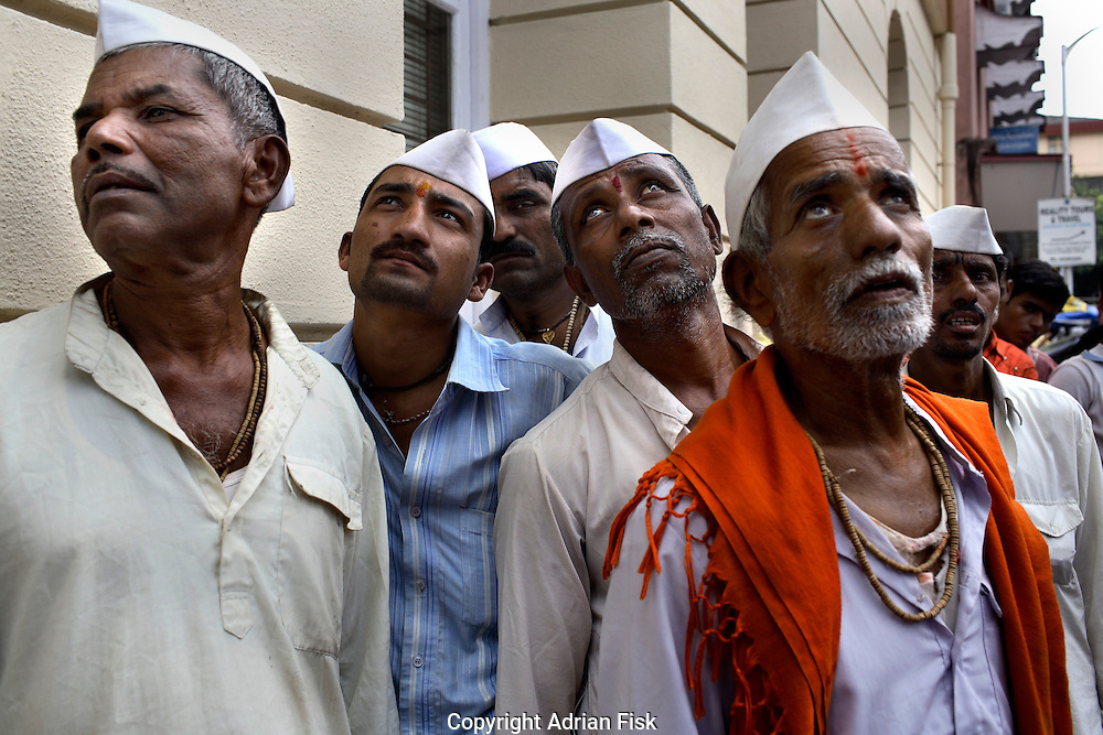 Traditionally dressed Bombay Hindus come to look at their famous Taj Mahal Hotel Hotel