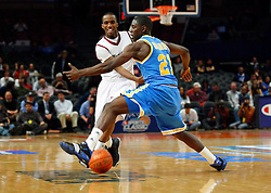 Nov 21, 2008; New York, NY, USA; UCLA Bruins guard Jrue Holiday (21) defends a pass by Southern Illinois Salukis guard Kevin Dillard (1) during first half action of the 2K Sports Classic consolation game at Madison Square Garden.