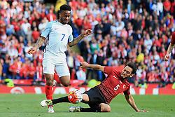 Raheem Sterling of England skips past Hakan Calhanoglu of Turkey  - Mandatory byline: Matt McNulty/JMP - 07966386802 - 22/05/2016 - FOOTBALL - Etihad Stadium -Manchester,England - England v Turkey - International Friendly