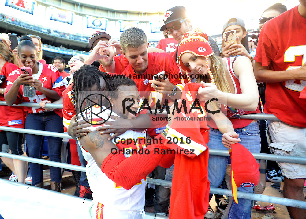 Nov 22, 2015; San Diego, CA, USA; Kansas City Chiefs strong safety Eric Berry (29) signs a fans jersey following the game against the San Diego Chargers at Qualcomm Stadium. Kansas City won 33-3. Mandatory Credit: Orlando Ramirez-USA TODAY Sports