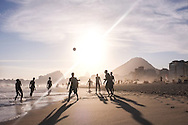 Playing football, Copacabana Beach at Sunset