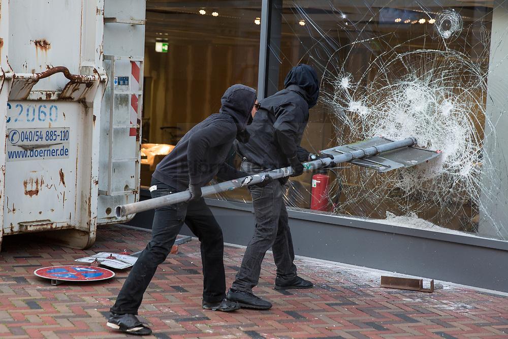Hamburg, Germany - 06.07.2017<br /> <br /> <br /> <br /> Protestors smash the windows of a IKEA. Radical left wing Anti-G20 protest &rdquo;Welcome to Hell&rdquo; in Hamburg. After the police stops the protests and run into it clashes took place in Hamburg.<br /> <br /> Demonstranten schlagen die Scheiben an einem IKEA ein. Linksradikale Anti-G20 Demonstration &rdquo;Welcome to Hell&rdquo; in Hamburg. Nachdem die Polizei die Demonstration gestoppt hat und in die Demo rannte kam es zu Ausschreitungen in Hamburg<br /> <br /> <br /> <br /> Photo: Bjoern Kietzmann