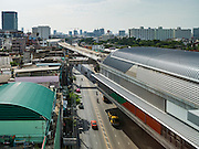 "23 AUGUST 2016 - NONTHABURI, NONTHABURI, THAILAND:  The not yet completed connection between the ""Blue Line"" and ""Purple Line"" commuter light rail in the Tao Poon station in Bangkok. The ""Purple Line"" is the new Bangkok commuter rail line that runs from Bang Sue, in Bangkok, to Nonthaburi, a large Bangkok suburb. The Purple Line is run by the  Metropolitan Rapid Transit (MRT) which operates Bangkok's subway system. The Purple Line is the fifth light rail mass transit line in Bangkok and is 23 kilometers long. The Purple Line opened on August 6 and so far ridership is below expectations. Only about 20,000 people a day are using the line; officials had estimated as many 70,000 people per day would use the line. The Purple Line was supposed to connect to the MRT's Blue Line, which goes into central Bangkok, but the line was opened before the connection was completed so commuters have to take a shuttle bus or taxi to the Blue Line station. The Thai government has ordered transit officials to come up with plans to increase ridership. Officials are looking at lowering fares and / or improving the connections between the two light rail lines.    PHOTO BY JACK KURTZ"