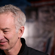 March 1, 2014, Indian Wells, California: <br /> John McEnroe is interviewed after the unveiling of a mural of himself during the McEnroe Challenge for Charity presented by Esurance at Indian Wells Tennis Garden. <br /> (Photo by Billie Weiss/BNP Paribas Open)