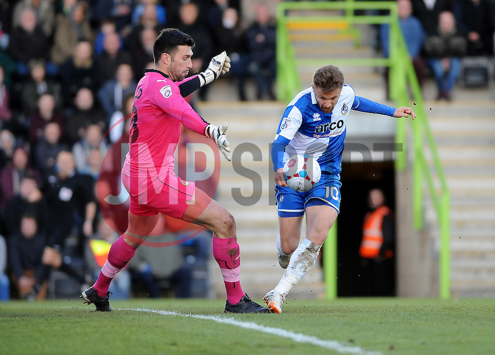 Bristol Rovers' Matty Taylor goes past Forest Green Rovers's Steve Arnold for the first goal - Photo mandatory by-line: Neil Brookman/JMP - Mobile: 07966 386802 - 29/04/2015 - SPORT - Football - Nailsworth - The New Lawn - Forest Green Rovers v Bristol Rovers - Vanarama Football Conference