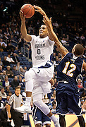 BYU forward Brandon Davies (0) goes up for a layup during the first half of the NCAA basketball game between the BYU Cougars and the Northern Arizona Lumberjacks at Marriott Arena, Thursday, Dec. 27, 2012.