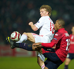 LILLE, FRANCE - Thursday, March 11, 2010: Liverpool's Dirk Kuyt and LOSC Lille Metropole's Emerson during the UEFA Europa League Round of 16 1st Leg match at the Stadium Lille-Metropole. (Photo by David Rawcliffe/Propaganda)
