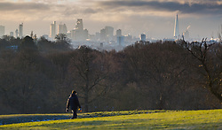 "A man walks across Hampstead Heath. The threatened snow from ""The Beast From The East"" weather system doesn't materialise overnight in London leaving a crisp, clear morning, seen from Hampstead Heath in North London. London, February 27 2018."