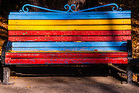 Russia, Sakhalin, Yuzhno-Sakhalinsk. Colourful bench in the Gagarin Park.