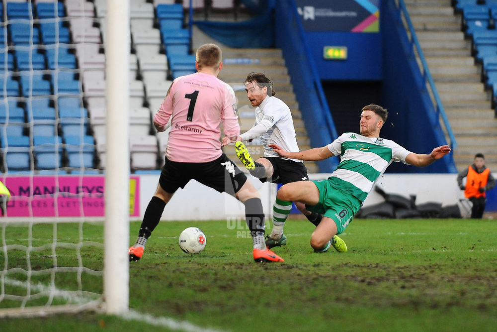 TELFORD COPYRIGHT MIKE SHERIDAN James McQuilkin of Telford shoots under pressure from Chris Atkinson during the Vanarama Conference North fixture between Darlington and Farsley Celtic at Tge New Bucks head Stadium on Saturday, December 7, 2019.<br /> <br /> Picture credit: Mike Sheridan/Ultrapress<br /> <br /> MS201920-033