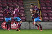 Scunthorpe United forward Kevin van Veen (10) celebrates scoring goal with Scunthorpe United defender Conor Townsend (3) and Scunthorpe United midfielder Duane Holmes (19) to go 1-1 during the EFL Sky Bet League 1 match between Scunthorpe United and Southend United at Glanford Park, Scunthorpe, England on 23 December 2017. Photo by Ian Lyall.