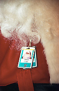 Santa Claus wears a Secret Service security pass during a preview of the 1998 White House Christmas decorations December 7, 1998 in Washington, DC. This year's theme was based around A Winter Wonderland.