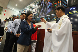 January 3, 2018 - Manila, Philippines - Traders receive communion during a holy mass moments before opening the first day of trade for the new year inside the Philippine Stock Exchange in the financial district of Makati, south of Manila on 03 January 2018. (Credit Image: © George Calvelo/NurPhoto via ZUMA Press)