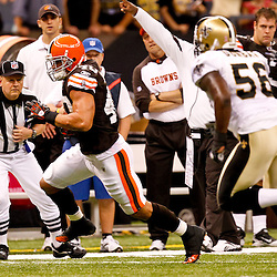 Oct 24, 2010; New Orleans, LA, USA; Cleveland Browns running back Peyton Hillis (40) runs as New Orleans Saints linebacker Jo-Lonn Dunbar (56) pursues the play during the second half at the Louisiana Superdome. The Browns defeated the Saints 30-17.  Mandatory Credit: Derick E. Hingle
