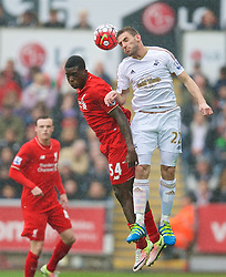 SWANSEA, WALES - Sunday, May 1, 2016: Liverpool's Sheyi Ojo in action against Swansea City's Angel Rangel during the Premier League match at the Liberty Stadium. (Pic by David Rawcliffe/Propaganda)