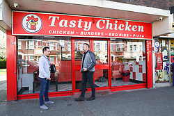 © Licensed to London News Pictures. 19/04/2019. London, UK. A crime detective officers outside Tasty Chicken. A 16 year old was shot just before 10 pm on Thursday 18 April 2019 outside Tasty Chicken on Burfield Close in Tooting. The victim is in a life threatening condition hospital. Photo credit: Dinendra Haria/LNP