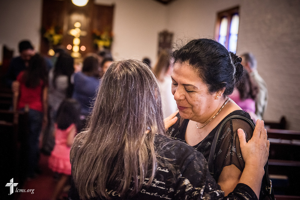 Anna Sanchez warmly embraces Sara Zambrano following worship at El Calvario Lutheran Church on Sunday, April 17, 2016, in Brownsville, Texas. LCMS Communications/Erik M. Lunsford
