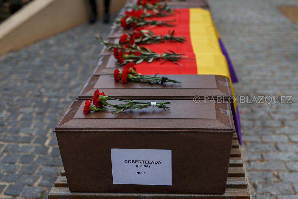 14/04/2018. Coffins containing the bodies of victims of Spain Civil War exhumed in Cobertelada and Calata&ntilde;azor are placed a bench in the center of Soria during a homage to hand the remains to their relatives on April 14, 2018 in Soria, Spain. La Asociacion Soriana Recuerdo y Dignidad (ASRD) 'The Soria Association for Memory and Dignity' celebrated a tribute to hand over the remains of civil war victims to their families. The Society of Sciences of ARANZADI helped with the research, exhumation and identification of the bodies, after villagers passed the information about the mass grave, 81 years after the assassination took place, to the ASRD. Seven people were assassinated around August 25, 1936 by Falangists, as part of General Francisco Franco armed forces, and buried in the 'Fosa de los Maestros' (Teachers Mass Grave) near Cobertelada, Soria, after being taken from prison of Almazan during the Spanish Civil War. Five of them were teachers in the region, and also friends of Spanish writer Antonio Machado. The other two still remain unidentified. Another body was assassinated by Falangists accompanied by a priest in 1936, and was exhumed on 23 September of 2017 near Calata&ntilde;azor, Soria. It belonged to Abundio Andaluz, a politician, lawyer and musician in Soria.<br /> Spain's Civil War took the lives of thousands of people on both sides, and civilians. But Franco continued his executions after the war has finished. Teachers, as part of the education sector, were often a target of Franco's forces. Spanish governments has never done anything to help the victims of the Civil War and Franco's dictatorship while there are still thousands of people missing in mass graves around the country. (&copy; Pablo Blazquez)