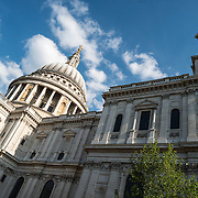 Side view of of St Paul's Cathedral, one of the most distinctive of London's landmarks. There has been a church on this site since 604 AD. The current building, with it's massive dome, was designed by Christopher Wren and dates back to the late 17th century.