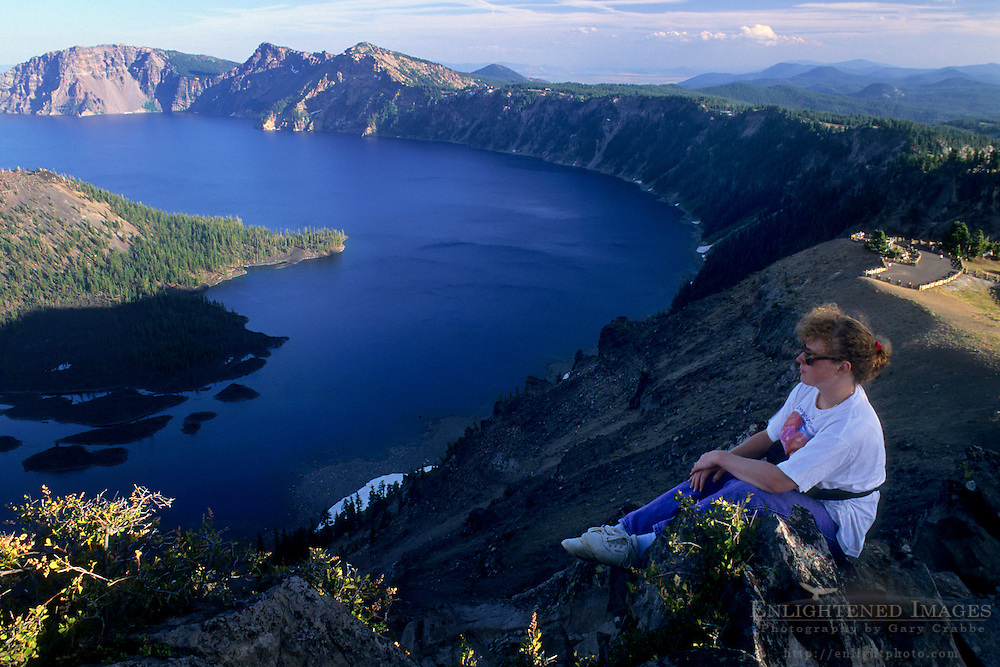 Tourist looking out over Crater Lake from high on the rim, Crater Lake National Park, Oregon