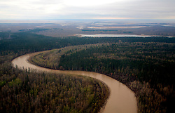 CANADA ALBERTA 12MAY07 - Aerial view of Athabasca River wetlands and Boreal forest...The Alberta Tar Sands are the largest deposits of their kind in the world and their production is the single largest contributor to Canada's greenhouse gas emissions...Alberta's tar sands are currently estimated to contain a crude bitumen resource of 315 billion barrels, with remaining established reserves of almost 174 billion barrels, thus making Canada's oil resources ranked second largest in the world in terms of size...The industry has brought wealth and an economic boom to the region but also created an environmental disaster downstream from the Athabasca river, polluting the lakes where water and fish are contaminated. The native Indian tribes of the Mikisew, Cree, Dene and other smaller First Nations are seeing their natural habitat destroyed and are largely powerless to stop or slow down the rapid expansion of the oil sands development, Canada's number one economic driver...jre/Photo by Jiri Rezac / WWF-UK..© Jiri Rezac 2007..Contact: +44 (0) 7050 110 417.Mobile: +44 (0) 7801 337 683.Office: +44 (0) 20 8968 9635..Email: jiri@jirirezac.com.Web: www.jirirezac.com..© All images Jiri Rezac 2007 - All rights reserved.