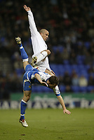 Photo: Aidan Ellis.<br /> Bolton Wanderers v Wigan Athletic. The Barclays Premiership. 04/11/2006.<br /> Bolton's Stellios and Wigan's Leighton Baines create a nice shape in the air
