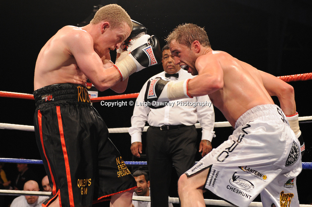 Ashley Sexton (white shorts) defeats Mike Robinson at London's Olympia on Saturday 30th April 2011 for the 8x3 mins Flyweight contest. Matchroom Sport. Photo credit © Leigh Dawney.
