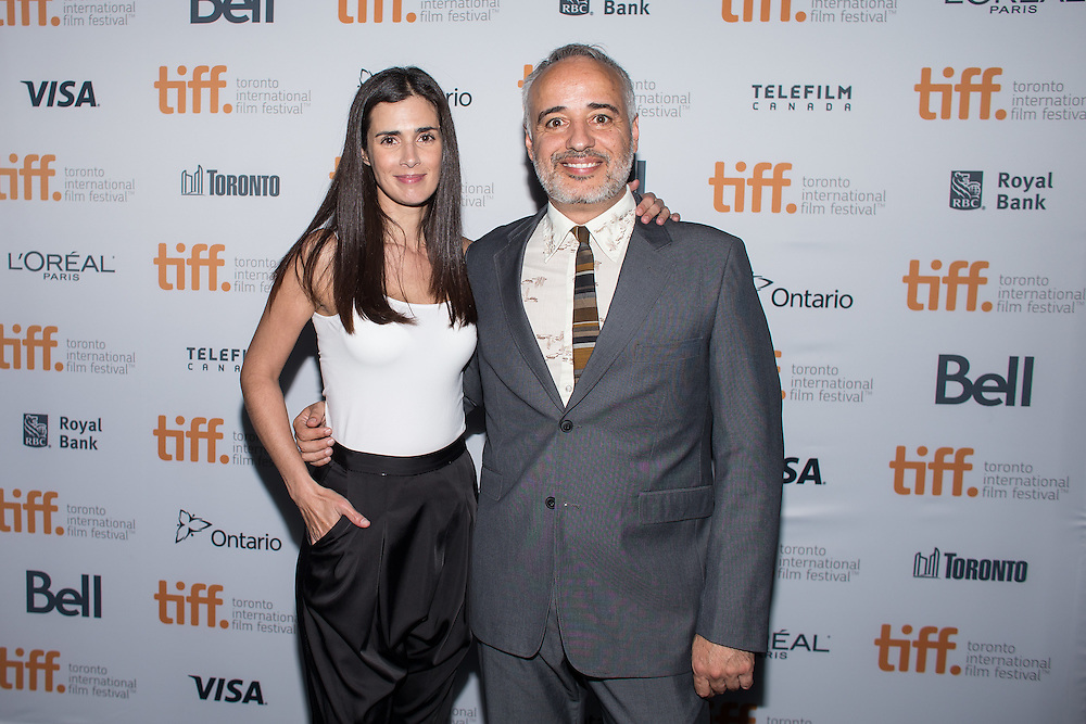 The Vanished Elephant star Vanessa Saba and Director Javier Fuentes-Le&oacute;n pose for photos following the film's premier at the Toronto International Film Festival in Toronto, Ontario, September 6, 2014.<br /> AFP PHOTO/Geoff Robins