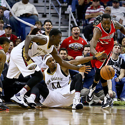 Mar 18, 2016; New Orleans, LA, USA; New Orleans Pelicans guard Jrue Holiday (11) and forward Dante Cunningham (44) scamble for a loose ball with Portland Trail Blazers forward Al-Farouq Aminu (8) during the second half of a game at the Smoothie King Center. The Trail Blazers defeated the Pelicans 117-112.  Mandatory Credit: Derick E. Hingle-USA TODAY Sports