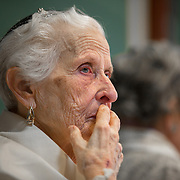 CHEVY CHASE, MD -MAY14: Charlotte Markowitz, 85, is emotional after she reads from the Torah following at her Bat-Mitzvah ceremony at the Five Star Residences in Chevy Chase, Maryland, May 14, 2016. The women who were unable to have a Bat-Mitzvah ceremony at the traditional age of 13 because they were girls, are now finally able to celebrate this traditional Jewish coming of age ceremony. (Photo by Evelyn Hockstein/For The Washington Post)