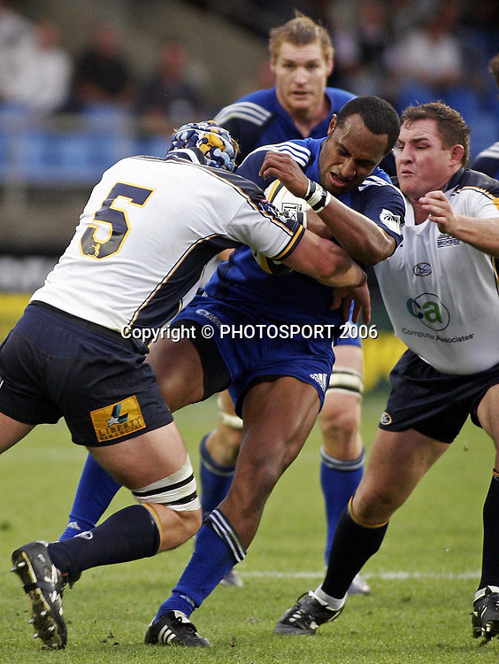 Blues wing Joe Rokocoko is tackled by Brumbies Mark Chisholm (L) during the Super 14 rugby union match between the Blues and the Brumbies at Eden Park, Auckland on Saturday 18 March 2006. The Blues won the game 26:15. Photo: Andy Song/PHOTOSPORT<br /> <br /> <br /> 150382