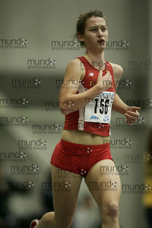 (Windsor, Ontario---12 March 2010) Genevieve Lalonde of University of Guelph Gryphons   competes in the 3000m final at the 2010 Canadian Interuniversity Sport Track and Field Championships at the St. Denis Center. Photograph copyright Geoff Robins/Mundo Sport Images. www.mundosportimages.com