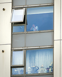 © Licensed to London News Pictures. 25/06/2017. London, UK.  A resident at the downey block holds her head in her hands. Residents have been asked to leave their apartments on the north London estate after government tests found cladding on the building were flammable, making the buildings unsafe. Over 80 residents are currently refusing to leave. Photo credit: Andre Camara/LNP