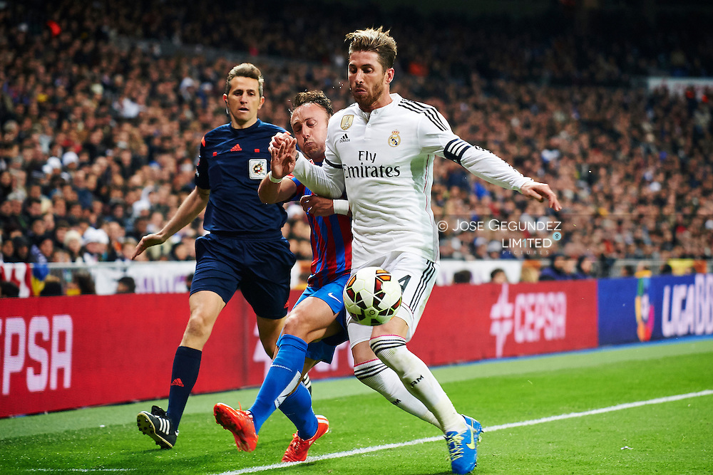Sergio Ramos (Real Madrid F.C.) and Xumetra (Levante) action during Real Madrid v Levante CF, La Liga football match at Santiago Bernabeu on March 15, 2015 in Madrid