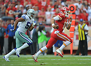 KANSAS CITY, MO - SEPTEMBER 15:  Quarterback Alex Smith #11 of the Kansas City Chiefs rushes past defensive end Kyle Wilber #51 of the Dallas Cowboys during the first half on September 15, 2013 at Arrowhead Stadium in Kansas City, Missouri.  (Photo by Peter G. Aiken/Getty Images) *** Local Caption *** Alex Smith;Kyle Wiber