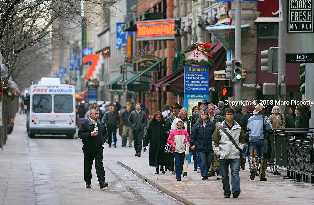 SHOT 1/15/08 1:58:36 PM - A lunchtime crowd packs the sidewalks along the 16th Street Mall in Denver, Co. The 16th Street Mall is a pedestrian and transit mall in Denver, Colorado. The mall, 1.25 miles (2 kilometers) long, runs along 16th Street in downtown Denver, from Wewatta Street (at Union Station) to the intersection of 16th Avenue and Broadway (at Civic Center Station). The 16th Street Mall opened in 1982, originally from Market Street to Broadway, and was originally designed by I.M. Pei, the notable architect of the Louvre Pyramid. The Mall was extended from Market Street to Wynkoop Street in 2001 and to Union Station in 2002 to coincide with the completion of the Central Platte Valley (CPV) light rail spur. Before 1982, 16th Street was still a shopping and business destination that was home to four major department stores and many office buildings. A free shuttle bus service along the mall, operated by the Regional Transportation District (RTD), is known as MallRide..(Photo by Marc Piscotty / © 2008)