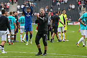 Forest Green Rovers assistant manager, Scott Lindsey applauds the away support during the EFL Sky Bet League 2 match between Milton Keynes Dons and Forest Green Rovers at stadium:mk, Milton Keynes, England on 15 September 2018.