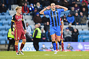 Gillingham FC forward Tom Eaves (9) scores a goal (2-0) and gestures to away fans  watched by former Gillingham team mate Bradford City  midfielder Josh Wright (44) during the EFL Sky Bet League 1 match between Gillingham and Bradford City at the MEMS Priestfield Stadium, Gillingham, England on 27 October 2018.