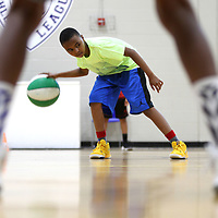 C.J Witherspoon, 11, of Tupelo works on his footwork and dribbling as he waits for more instruction from his coach Milton Moore during Basketball Camp at the Tupelo Police Athletic League on Thursday morning. The camp, which ends Friday, focuses on the fundamentals of the game and was led by Jason Smith and Milton Moore. The age group for this weeks camp was 10-14. A camp will be held next month, July 9-13, for ages 14 and up at no charge on a first come first serve basis until all 40 spots are filled.