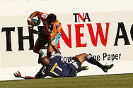 Ederies Arendse tackles Robert Ebersohn during the DHL Pre-Season Series match between The Stormers and the Cheetahs held at Newlands Rugby Stadium in Newlands, Cape Town on the 4th February 2012.Photo by Ron Gaunt/SPORTZPICS