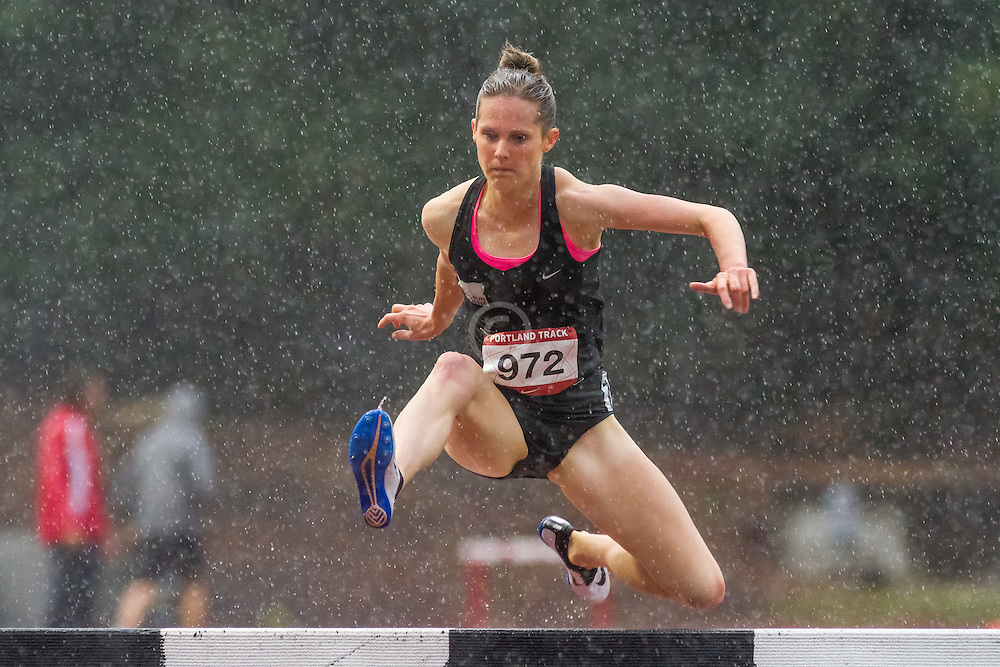 Megan Patrignelli of Team Run Eugene takes the last barrier en route to winning the womens 3000 meter steeplechase in 9:43.37, reaching the Olympic qualifying standard on a cold and very rainy evening in Portland Oregon