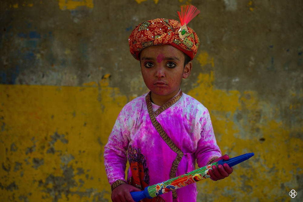 A cute little kid drenched in holi colors during the early hour walk across the streets of Barsana. <br /> <br /> Nikon D4s | Nikkor 70-200 | f4 | 1/800s | ISO 400 <br /> <br /> www.subodhshetty.com