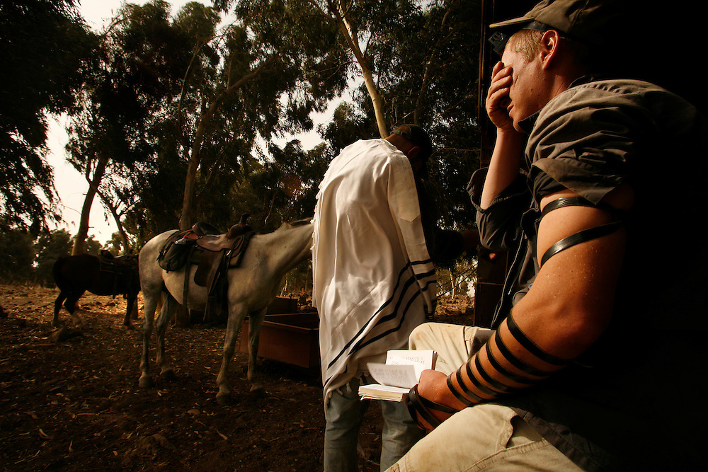 Yehuda Gilad 27( on the right) and   Yair Negev 24 prying the morning prays after patrolling the cow flock of Moshav Yehonatan in the Golan height, Israel. Sunday October, 07, 2007