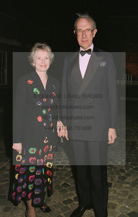 SIR ANGUS & LADY STIRLING he is director general of the National Trust, at a party on April 4th 1997.LXJ 20