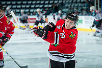 KELOWNA, CANADA - APRIL 8: Ryan Hughes #19 of the Portland Winterhawks warms up with a shot on net against the Kelowna Rockets on April 8, 2017 at Prospera Place in Kelowna, British Columbia, Canada.  (Photo by Marissa Baecker/Shoot the Breeze)  *** Local Caption ***